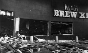 Wreckage and debris litter the street outside the Mulberry Bush pub in Birmingham, after the bombing.