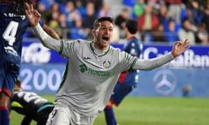 Getafe's Jorge Molina celebrates after scoring at Huesca.