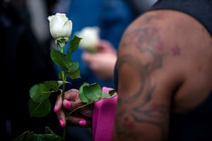 A transgender rights activist holds a white rose while protesting against the recent killings of three transgender women, Muhlaysia Booker, Claire Legato, and Michelle Washington, during a rally at Washington Square Park in New York, U.S., May 24, 2019.