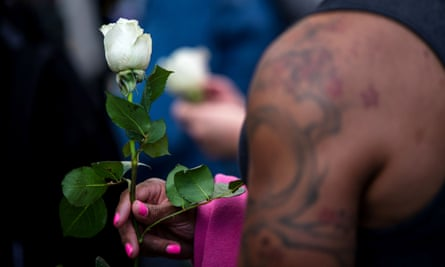 A trans rights activist holds a white rose while protesting against the recent killings of three transgender women during a rally in New York City on 24 May 2019.