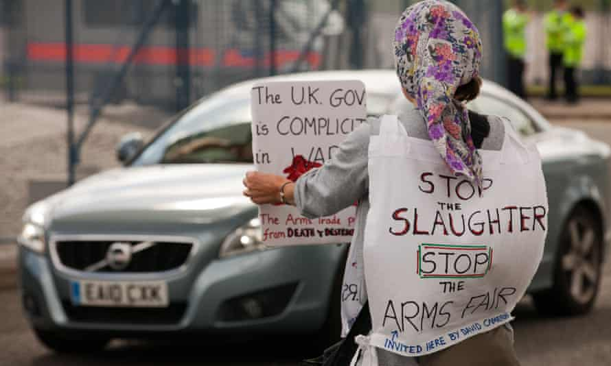 A protester stands outside the DSEI arms fair at the ExCel Centre last year.
