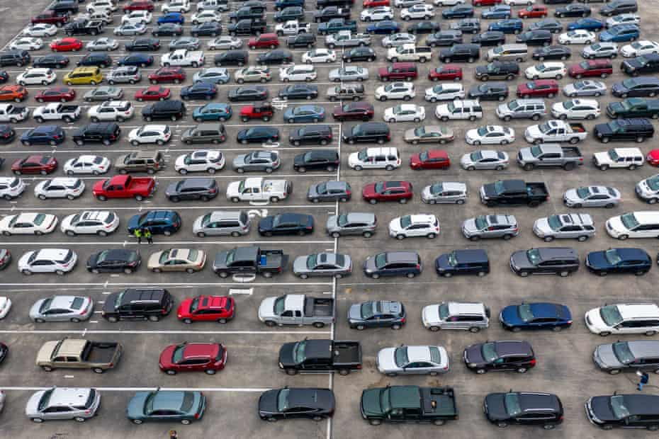Hundreds of cars wait in line at a food bank in Austin, Texas, on 23 November.