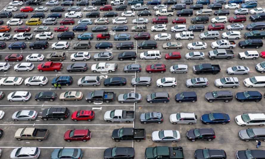 Hundreds of cars wait in line at a food distribution event amid the coronavirus outbreak in Austin, Texas, last month.