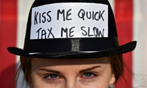 A woman participates in a protest against tax havens, at Trafalgar square in London