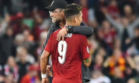 Liverpool's manager Jürgen Klopp hugs Roberto Firmino after the final whistle.