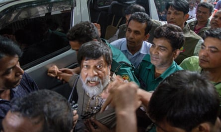 Police escort the photographer Shahidul Alam outside the chief metropolitan magistrate court in Dhaka