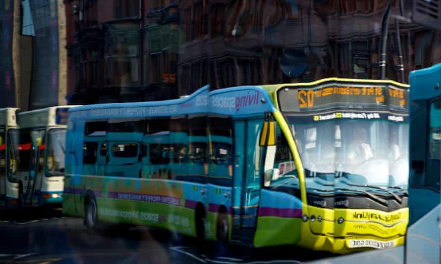 Buses are reflected in the windows of another bus at Haymarket bus station in Newcastle upon Tyne.
