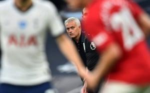Jose Mourinho keeps an eye on proceedings.