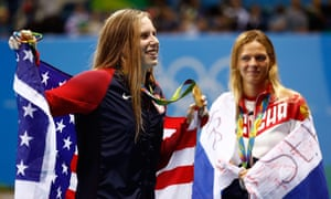 Lilly King celebrates her gold medal in the 100m breaststroke as silver medallist Yulia Efimova looks on
