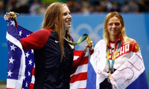 Lilly King (left) celebrates her 100m breaststroke gold as Yulia Efimova looks on
