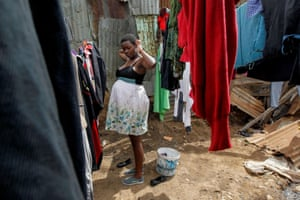 Jackline Bosibori, 17, who is pregnant, stands outside her home in Lindi village within the Kibera slums in Nairobi
