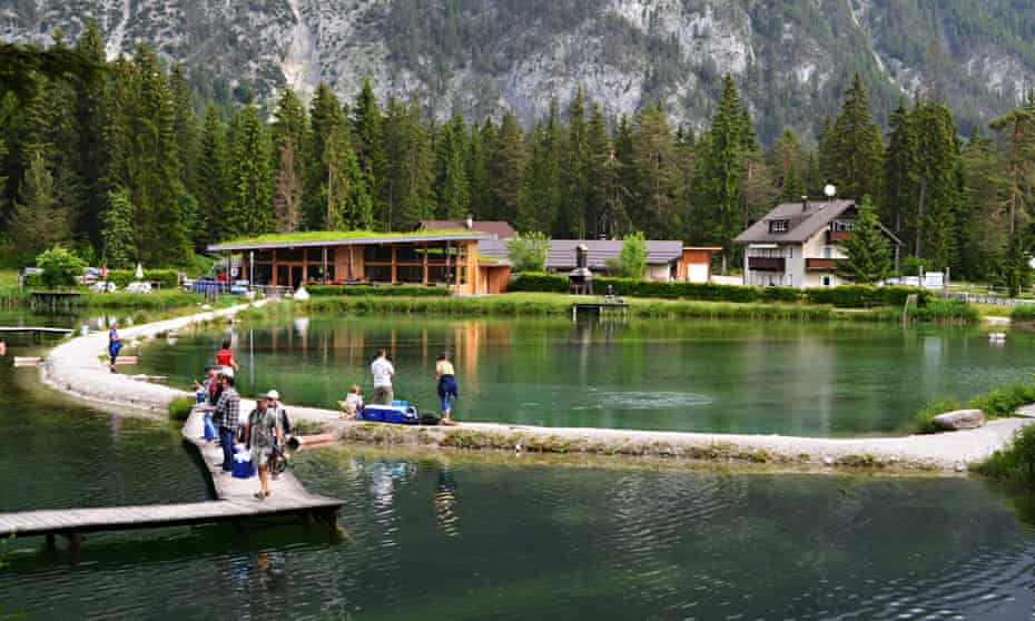 families playing and fishing at Weidachsee, Tirol