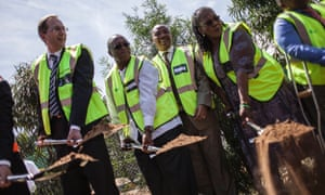 Henri Poupart-Lafarge, left, CEO of French transport group Alstom, breaks ground with South African minister of transport Dipuo Peters, to his right, for a new joint venture in South Africa
