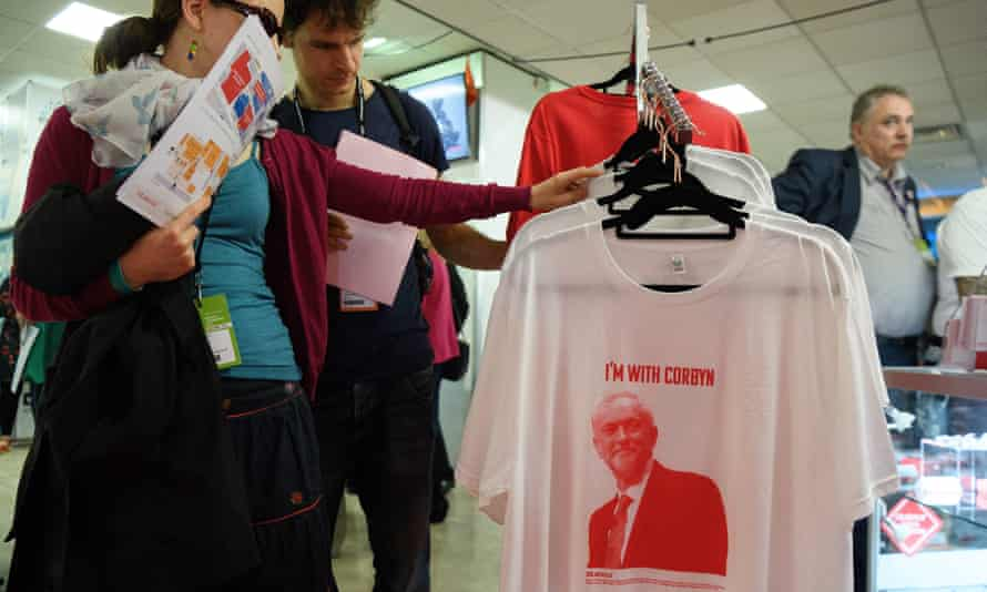People browse Jeremy Corbyn-themed T-shirts at the Labour conference