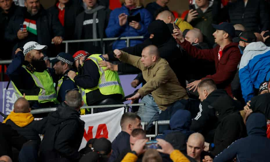 Police and Hungary fans clash in the first half of the World Cup qualier at Wembley.