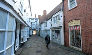 A person walks down a quiet street during lockdown in Newark-on-Trent in Nottinghamshire.