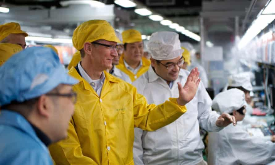 Apple boss Tim Cook visits an iPhone production line in Zhengzhou, China.