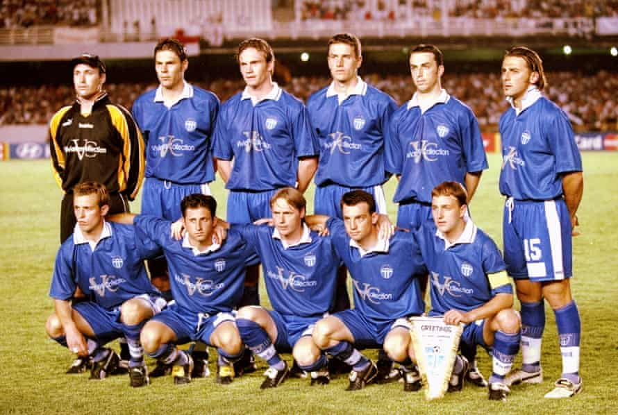 The South Melbourne players sport the rather uninspired all-blue kit with just one sponsor on the front of the shirts.