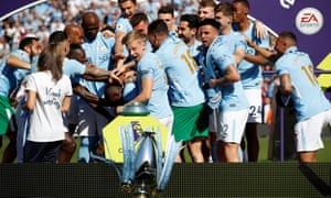 Manchester City's Oleksandr Zinchenko reacts as the Premier League trophy falls to the floor during their title celebrations.
