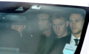 Jürgen Klopp is driven away after arriving at John Lennon Airport in Liverpool.