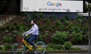 A man cycles past Google campus in San Francisco