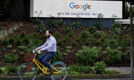 A man cycles past Google campus in San Francisco