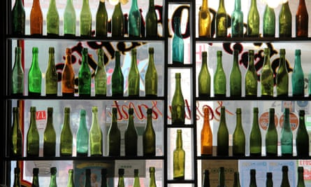 Rows of empty beer bottles on display in the window at Restobiere, Brussels. Belgium.