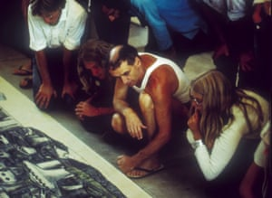 Paolo Soleri and acolytes study his plans in the mid-70s.