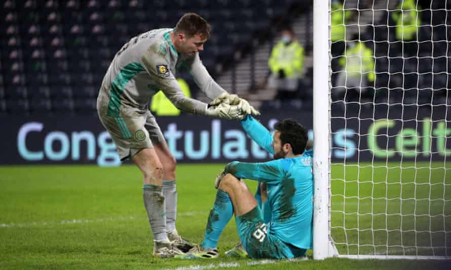 Victorious goalkeeper Conor Hazard (left) consoles Hearts' Craig Gordon, formerly of Celtic, after the penalty shootout.