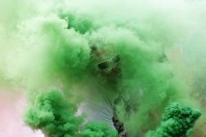 A Hungarian fan with a green flare near Marseille's Stade Vélodrome ahead of Hungary's 1-1 draw with fellow Group F surprise package Iceland
