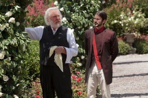 Donald Sutherland as President Snow pruning roses in The Hunger Games