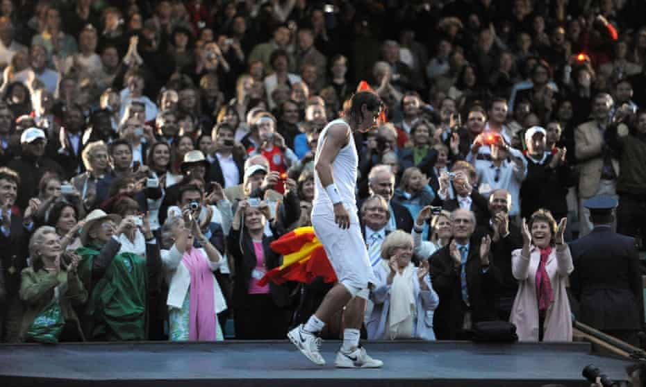 Rafael Nadal climbs on the roof of the commentary boxes to get to the Royal Box to greet Spain's Crown Prince Felipe and Princess Letizia.
