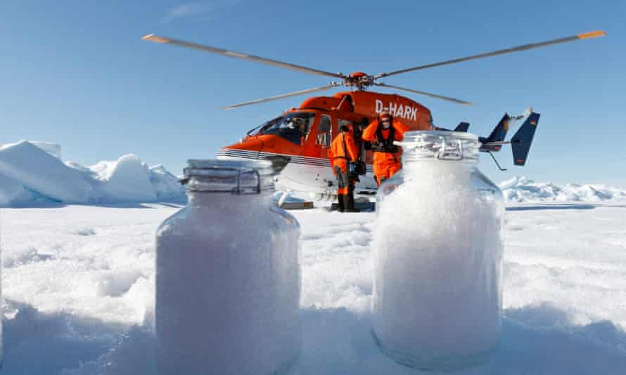 Scientists collect snow samples above the Arctic circle.