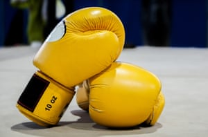 Yellow boxing gloves in a ring
