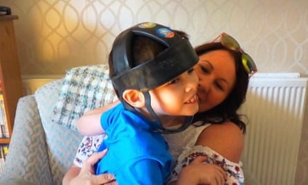 Joanne Griffiths and son Ben, wearing a protective helmet.