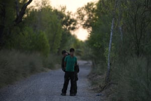 A US border patrol agent apprehends a migrant who illegally crossed the Rio Grande and attempted to avoid capture near Mission, Texas.