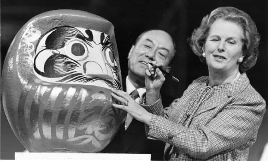 Margaret Thatcher with a Japanese Daruma doll during the opening ceremony for the Nissan factory in Sunderland, 1986.