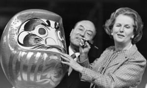Margaret Thatcher painting the eye of the Daruma doll at the opening of the Nissan plant in 1986.