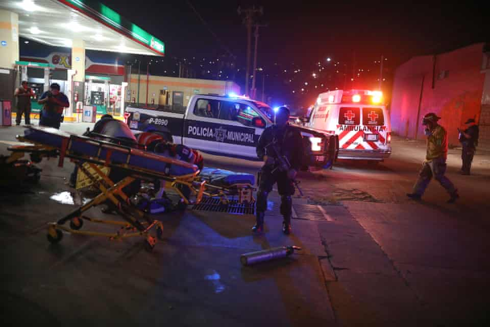 Police and emergency workers descend on a petrol station in Tijuana last month after a drive-by shooting left four men injured