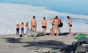 The four were among this group of backpackers who stripped on top of Mount Kinabalu.