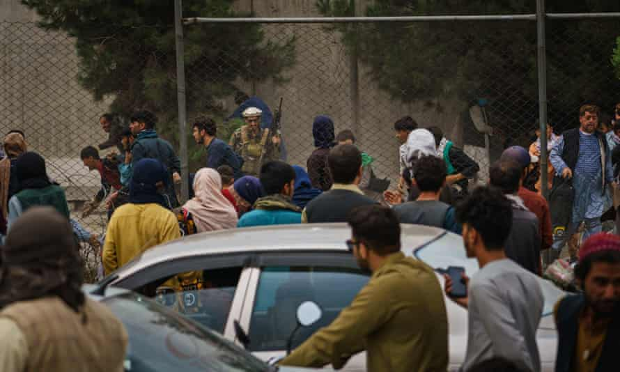 Taliban fighters have reportedly beaten crowds of Afghans who continue to wait outside Kabul airport, hoping to flee Afghanistan.