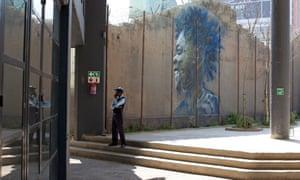 A security guard outside the new Joziburg Lane development in central Johannesburg.