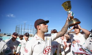 Jade Dernbach of Surrey celebrates with the County Championship Division One Cup.