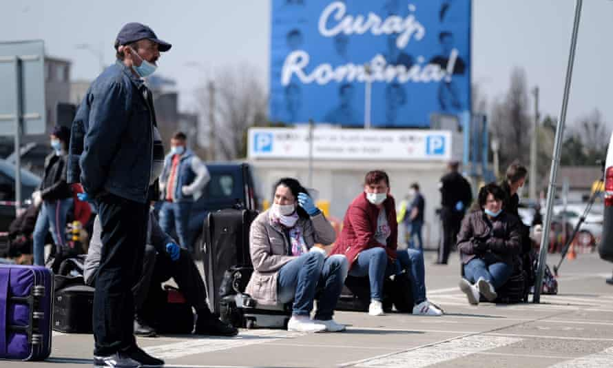Romanians wait at Cluj-Napoca international airport to travel to Germany