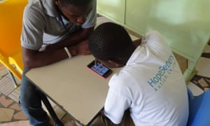 A student uses a new app designed to help autistic children learn at HopeSetters autism centre in Tema, Ghana