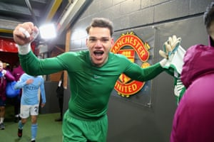 Ederson celebrates in the tunnel after Manchester City's win.