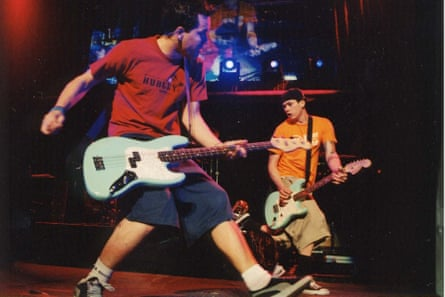 'On tour, I'd be reading these books full of government documents' … Tom DeLonge with Mark Hoppus in Blink-182.