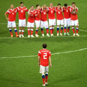Russia's Mário Fernandes heads back towards his teammates after missing in the shootout.
