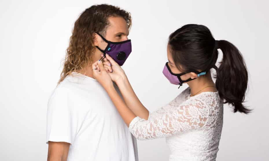 Models adjust colourful masks from Cambridge Mask Co.