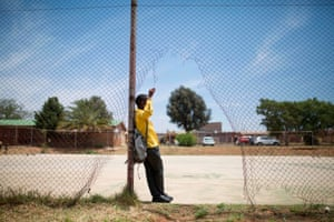 A student from the Soweto rugby school academy waits before practice.